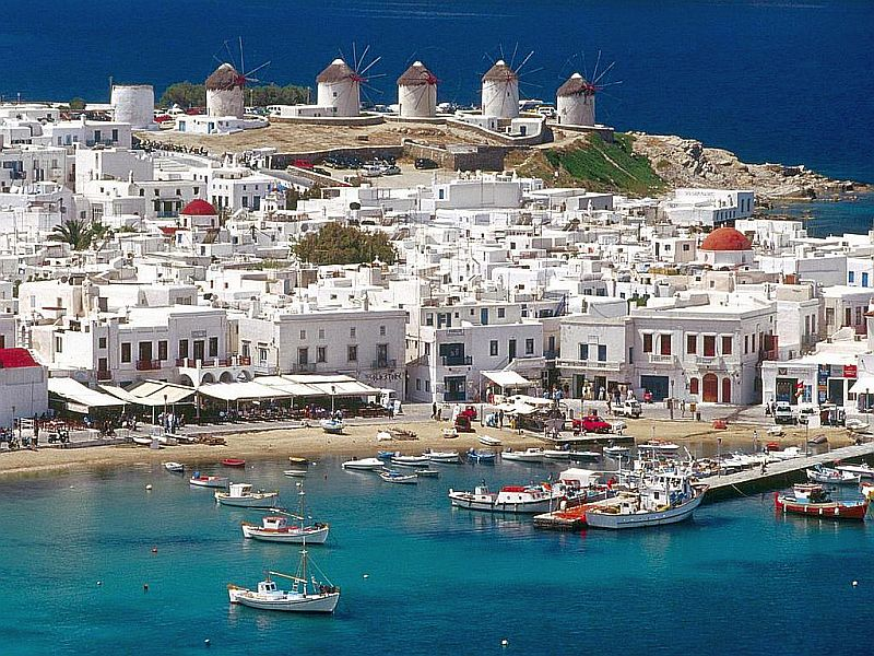 Beautiful Sunny Mykonos. It's all blue and white. Try the fish eye soup when you visit this isle.