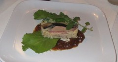 Duck Terrine with caramelized onion coulis and house grown mustard greens